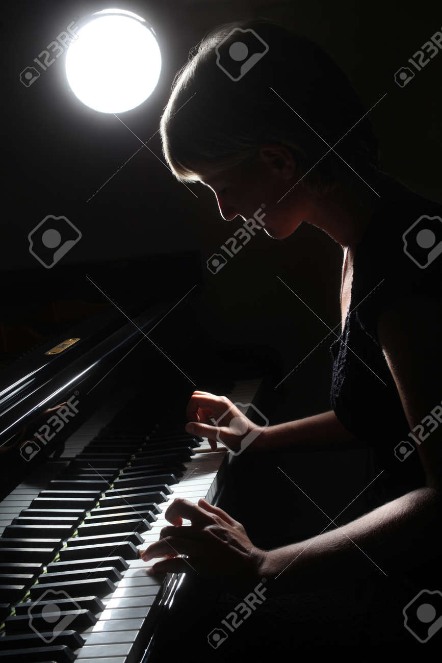 Piano classical music musician player  Pianist with grand piano musical instrument Standard-Bild - 21499760