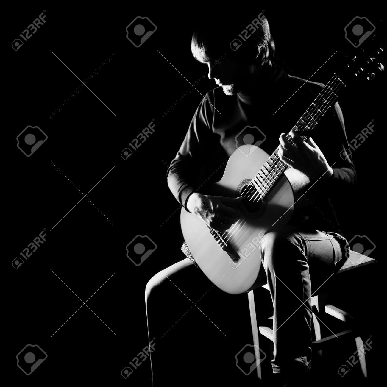 Acoustic guitar player guitarist  Classical guitar musical instruments concert playing in darkness Standard-Bild - 26131333