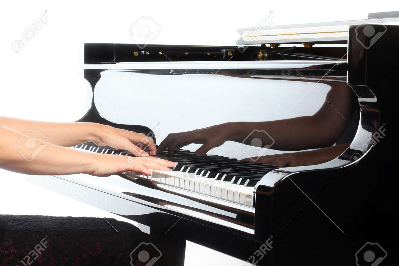 Piano hands pianist playing  Musical instruments details with player hand closeup Standard-Bild - 26131360