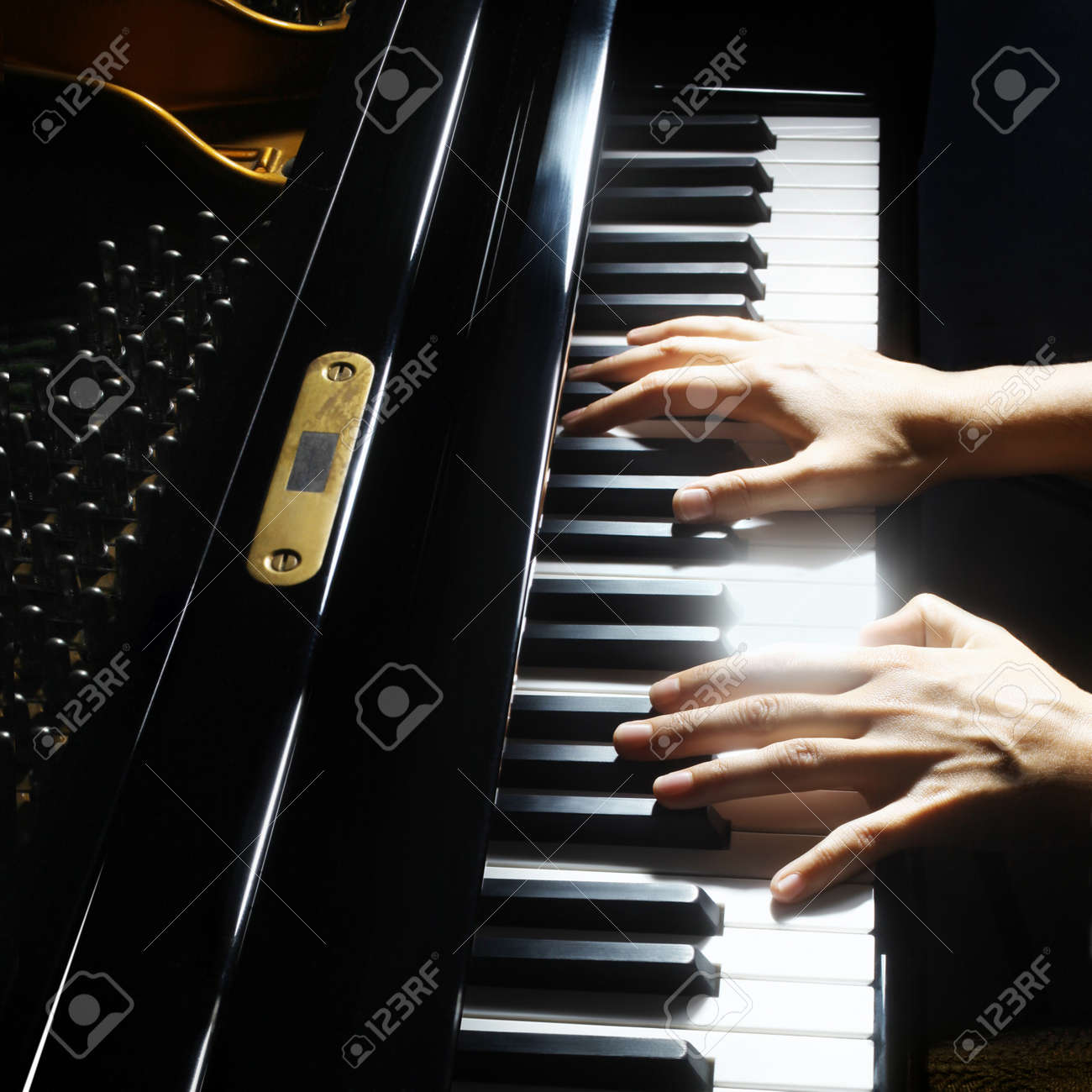 Piano hands pianist playing  Musical instruments details with player hand closeup Standard-Bild - 26131361