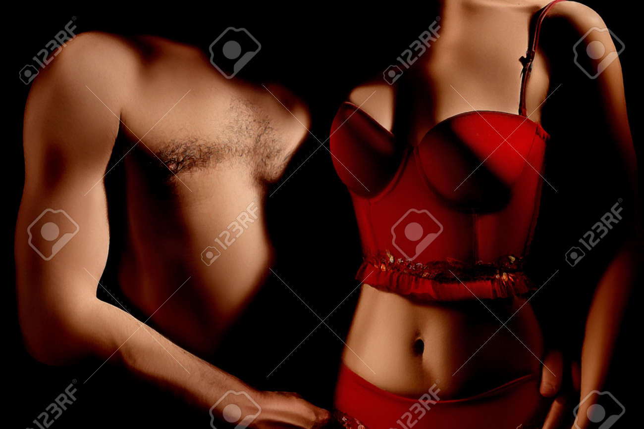 Nude sexy couple in darkness  Erotic Woman in red lingerie Standard-Bild - 26131365