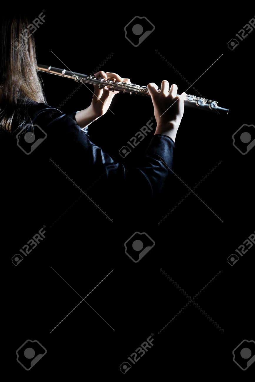 Flute player with music instrument Flutist playing concert Standard-Bild - 29733923