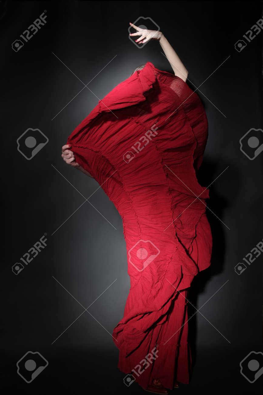 Flamenco dancer in red dress  Woman dancing in long flying dress Standard-Bild - 30695093