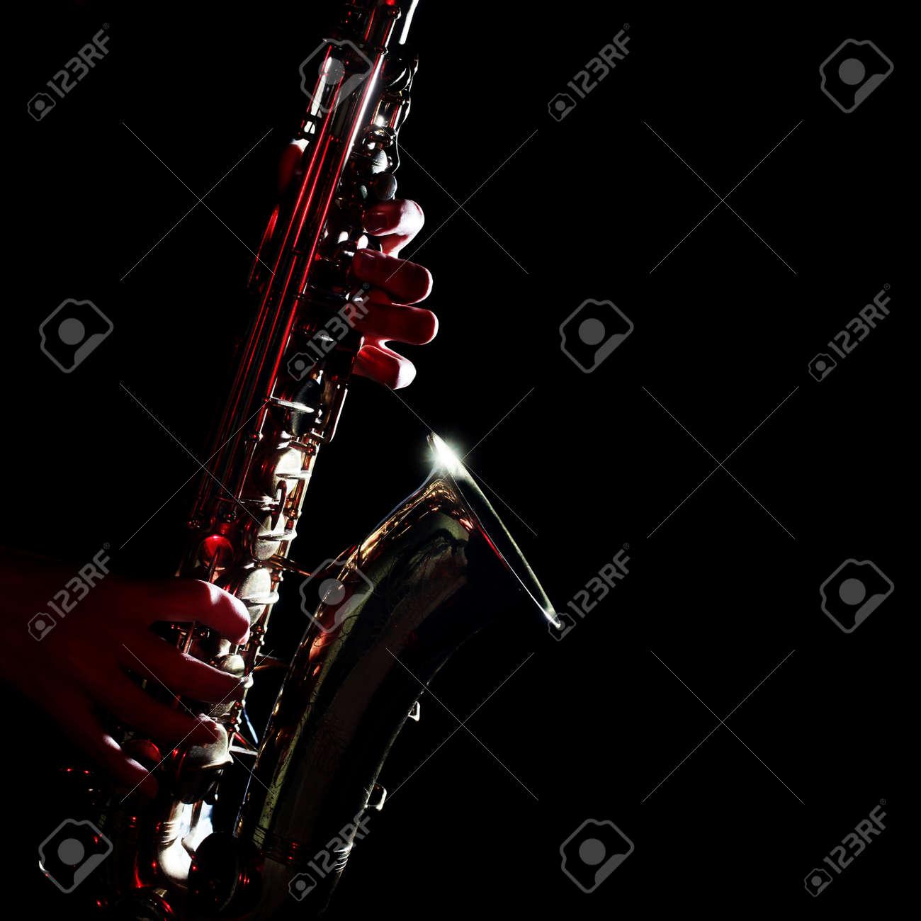Saxophone isolated on black closeup  Saxophonist with alto sax music instruments Standard-Bild - 35860658