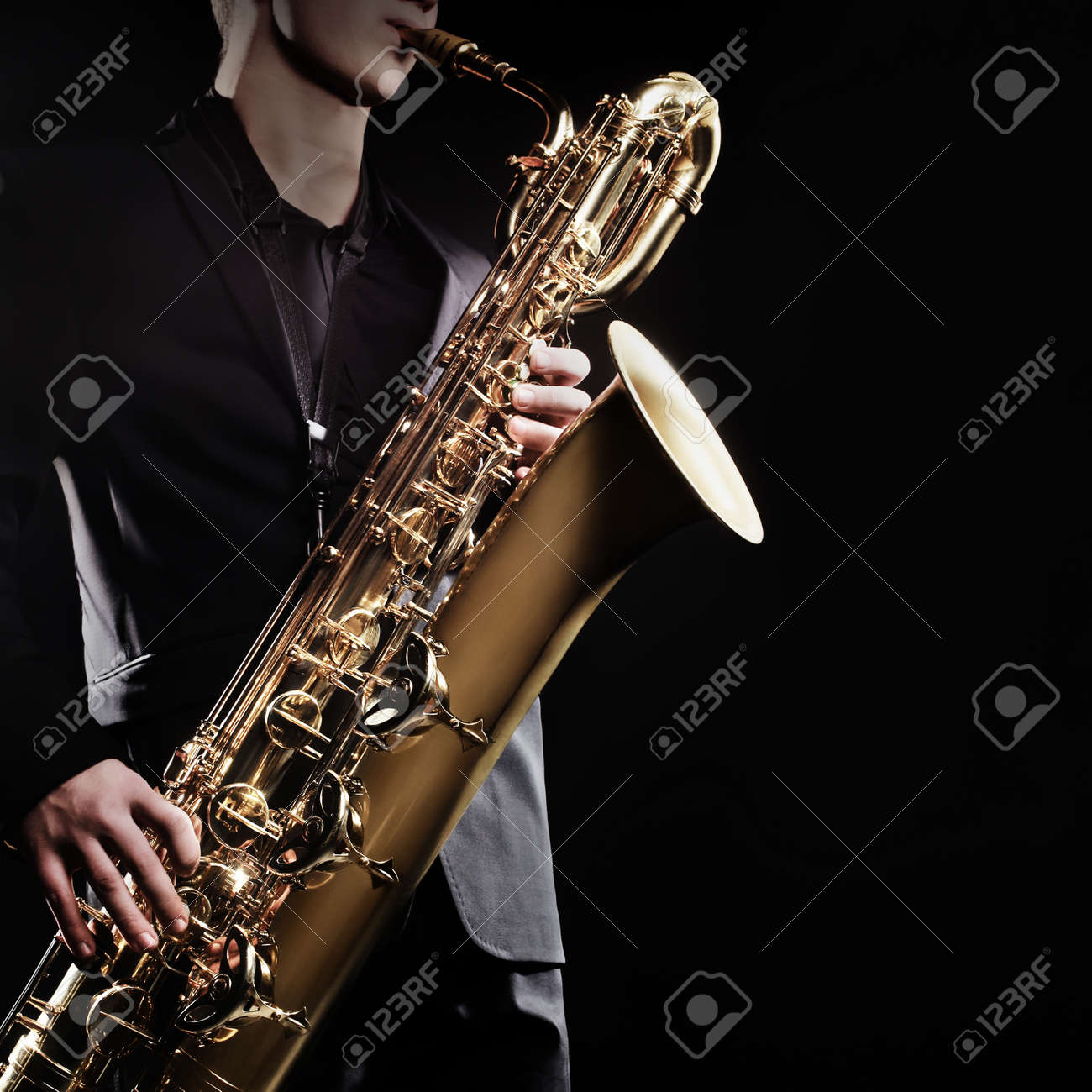 Saxophone baritone Saxophonist with sax jazz music instruments Standard-Bild - 38638624