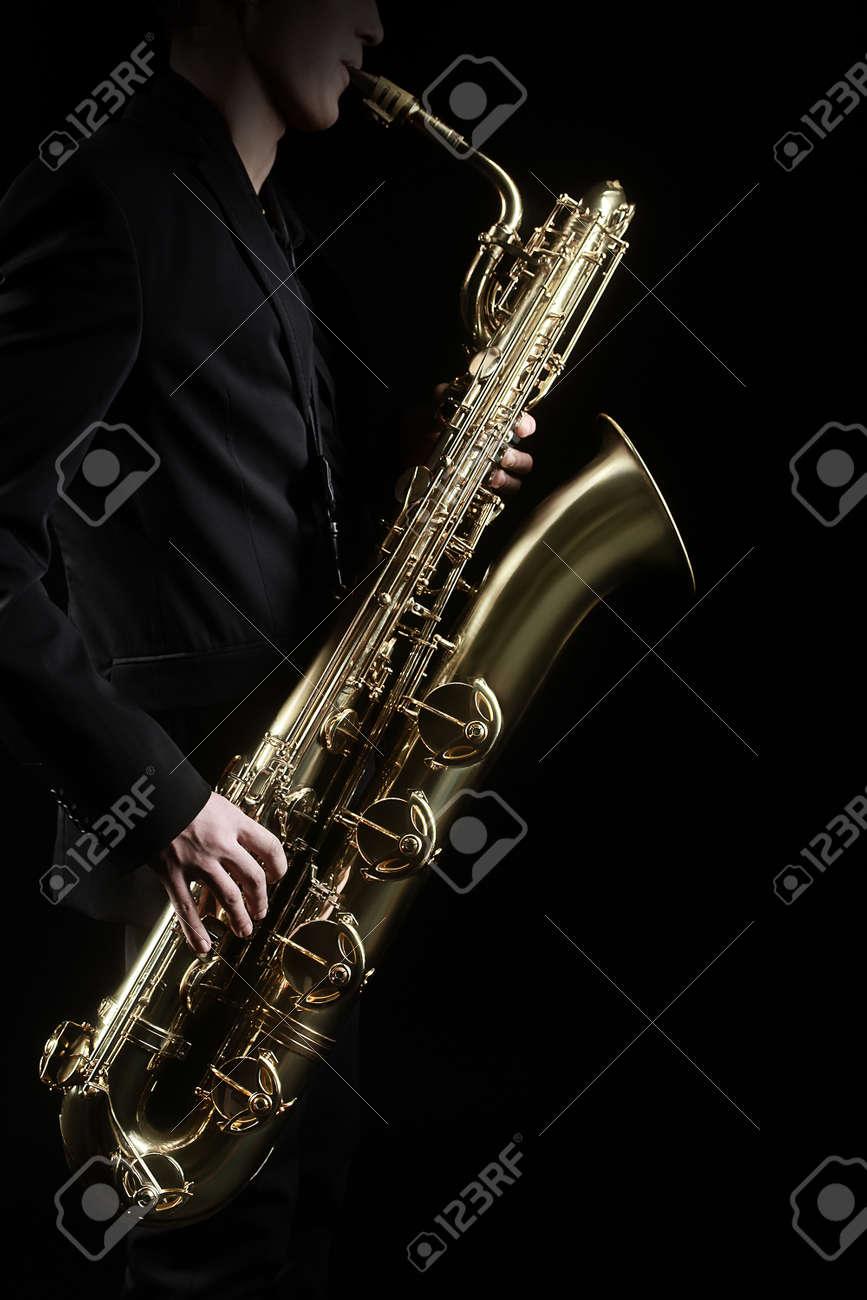 Saxophone Jazz Music Instruments Saxophonist with Baritone Sax player isolated on black Standard-Bild - 42770445