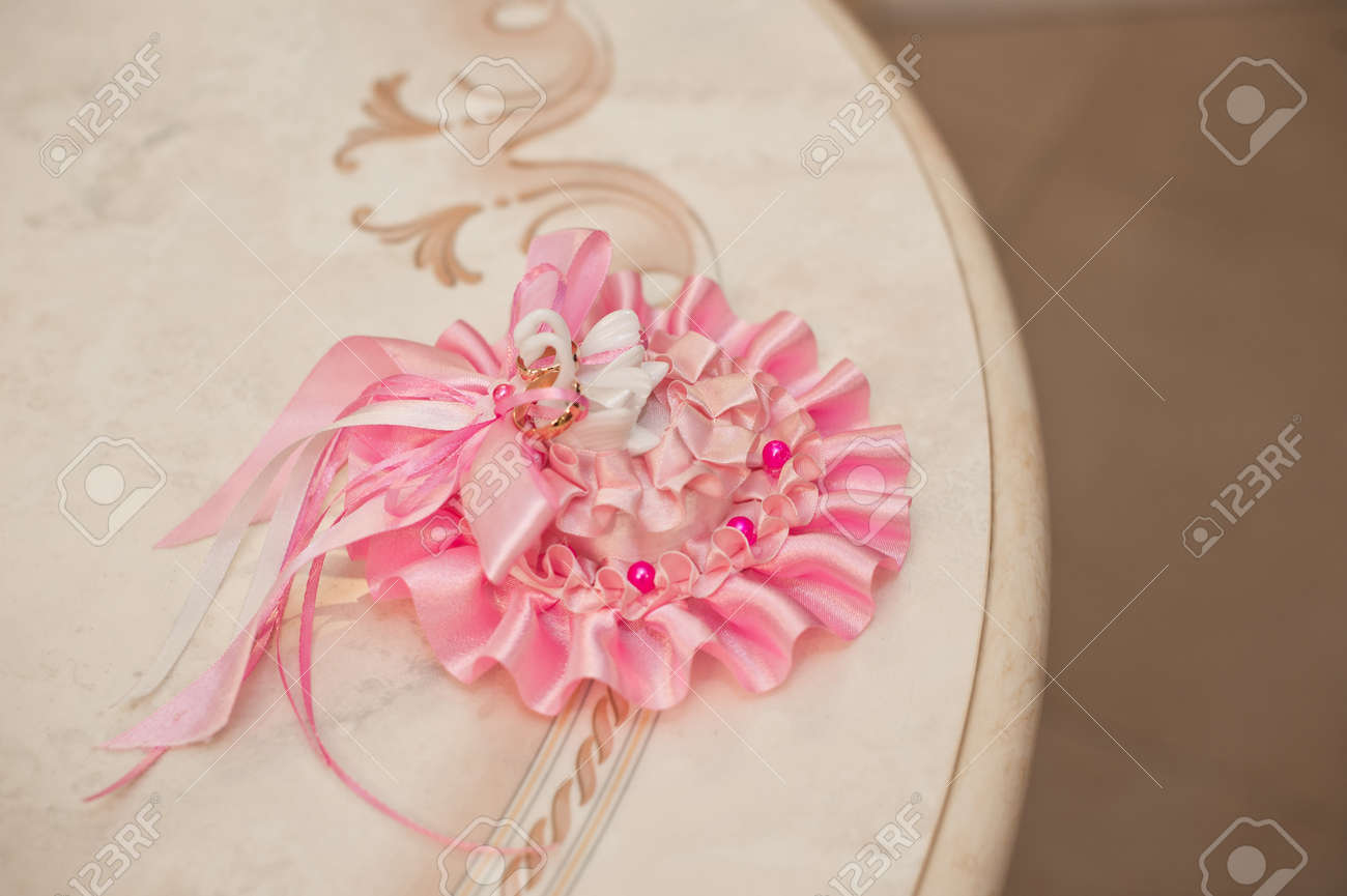 Wedding Rings On A Pink Pillow Before Process. Stock Photo, Picture ...