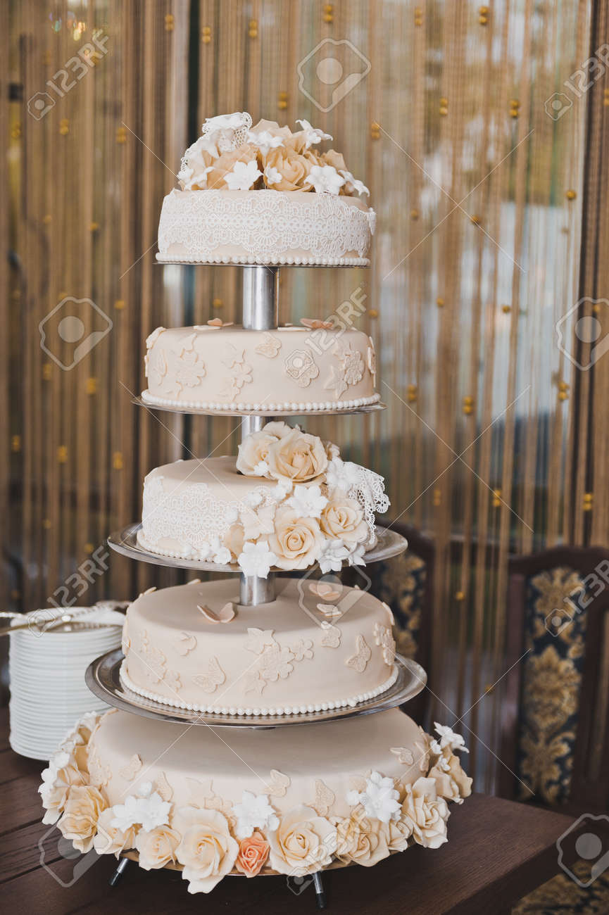 A Large Wedding Cake In Four Floor Stock Photo Picture And