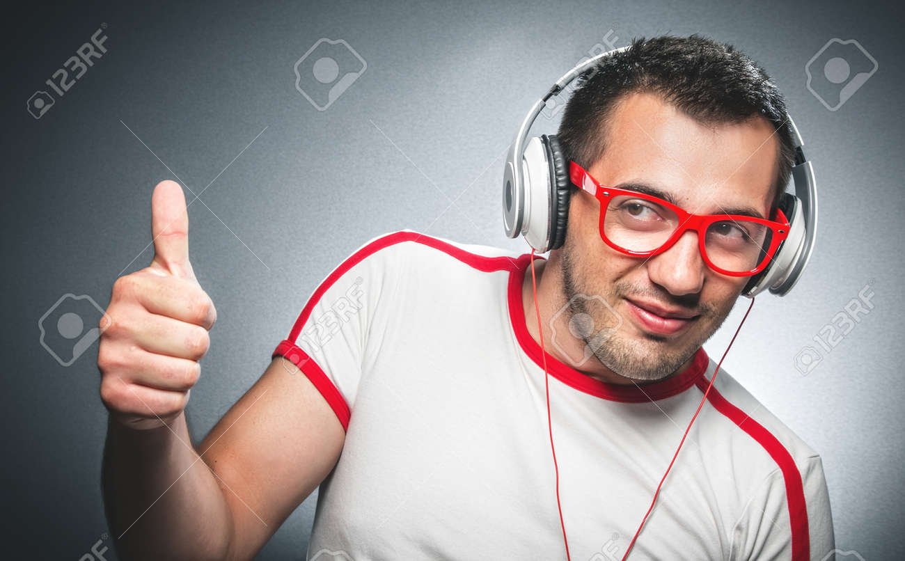 Funny Man Enjoying Listening Music With Headphones And Showing