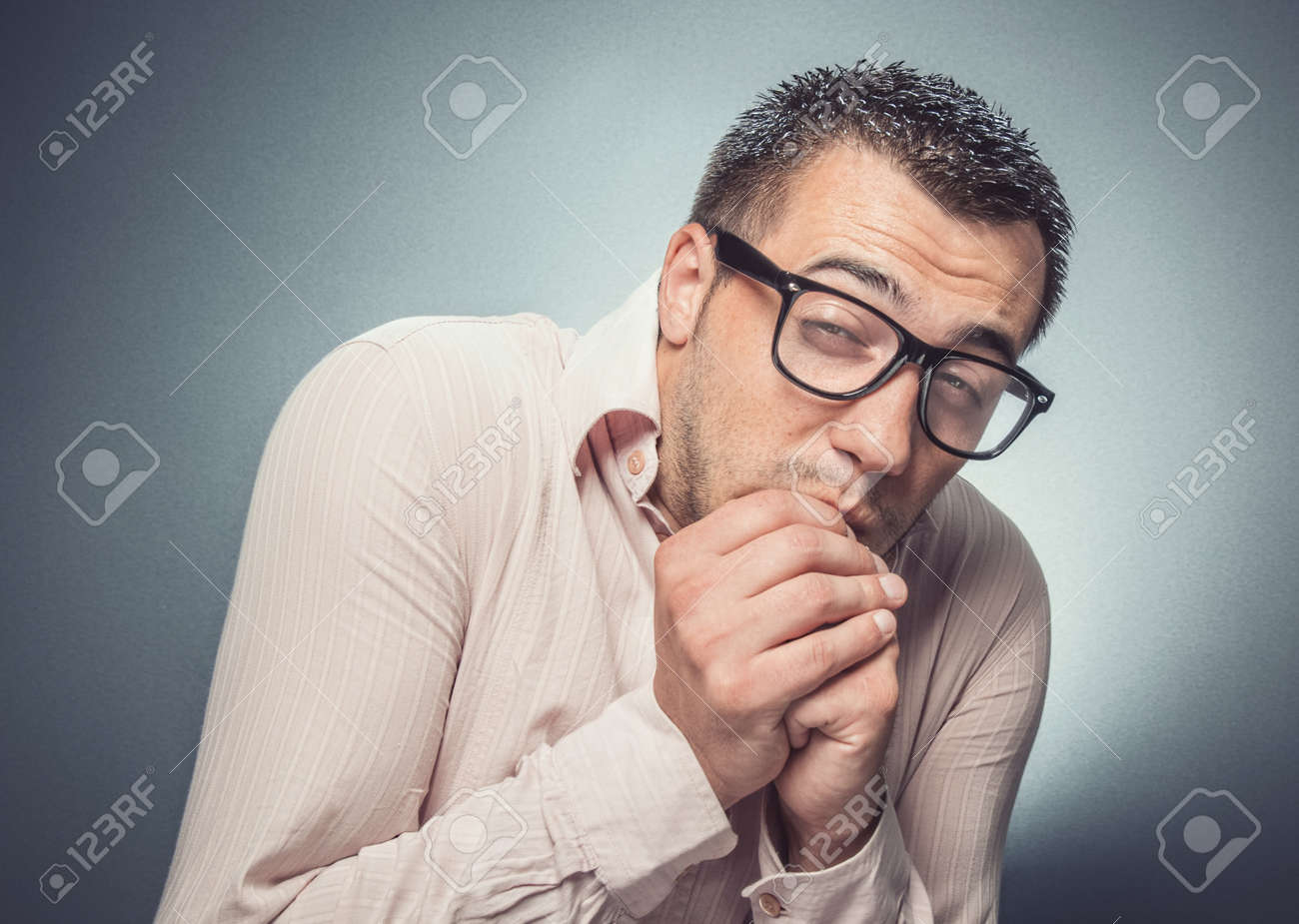 Man Biting Nails In Fear. Close Up Of A Funny Businessman Over ...