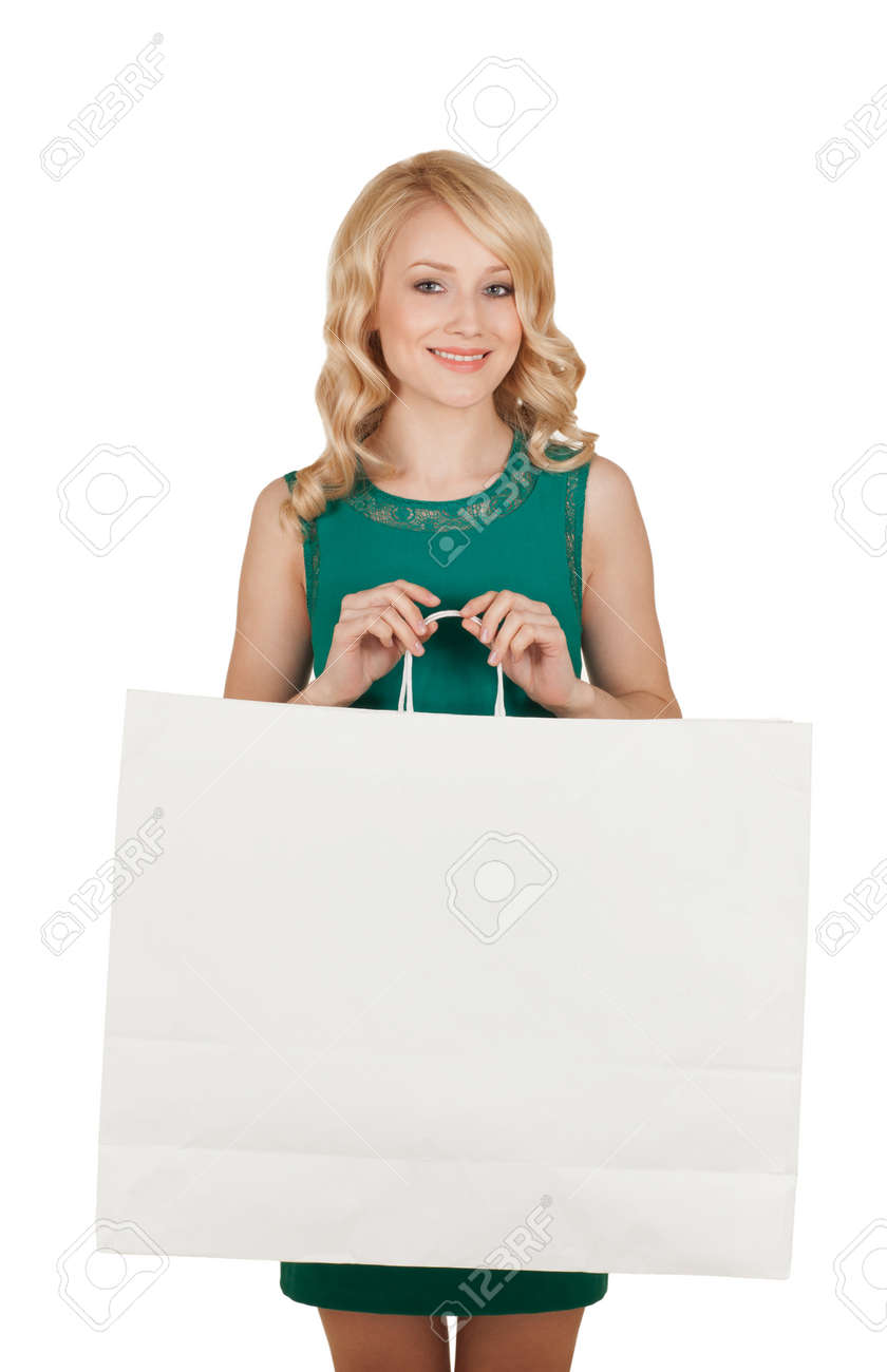 the beautiful blonde in a green dress holds a big package with purchases Stock Photo - 20700209
