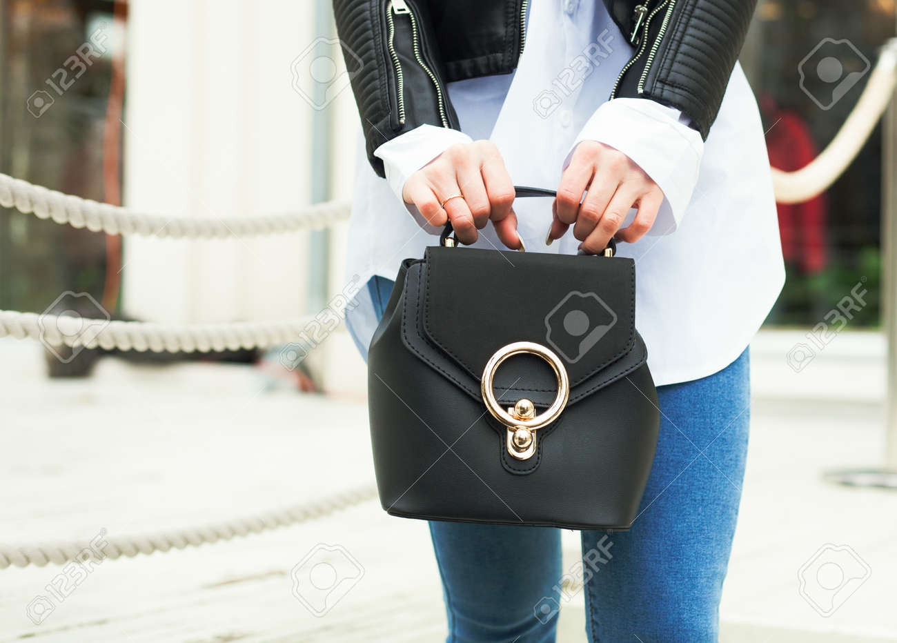 Fashion and Beauty  The girl is holding a fashionable small handbag