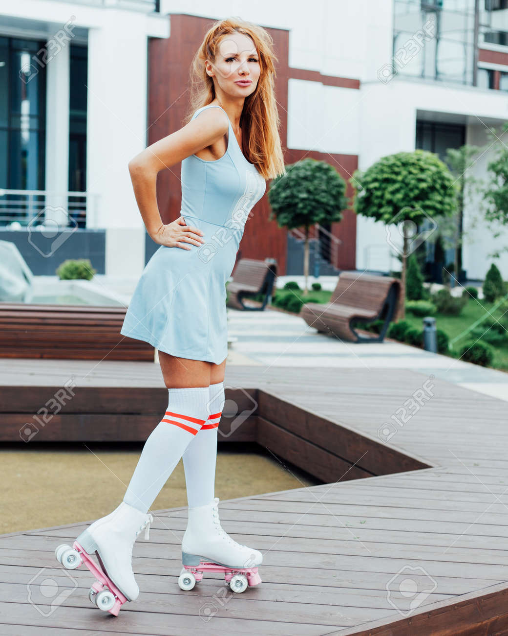 cb4d414270fb An incredible red-haired beauty is having fun outdoors in a trendy blue summer  dress