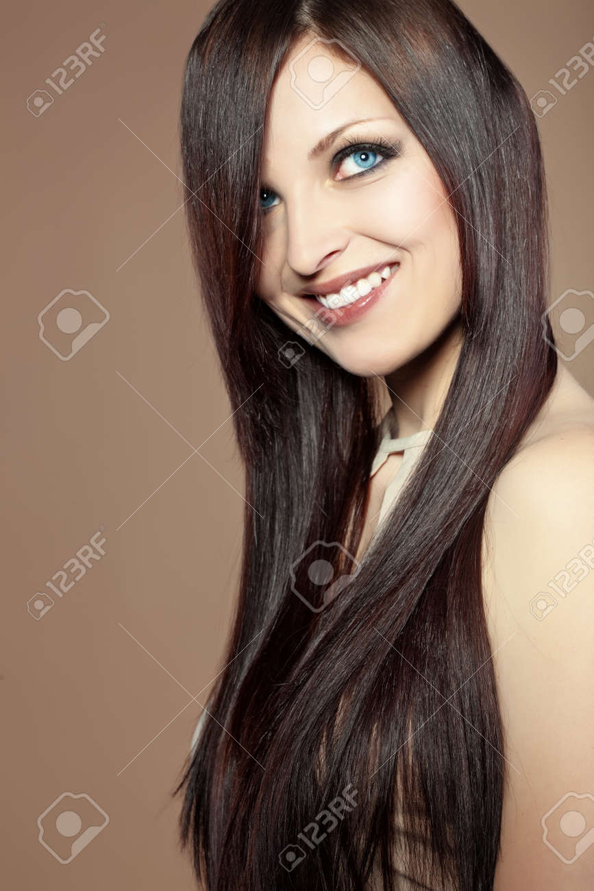 Portrait of young beautiful woman with long glossy hair Stock Photo - 13064164