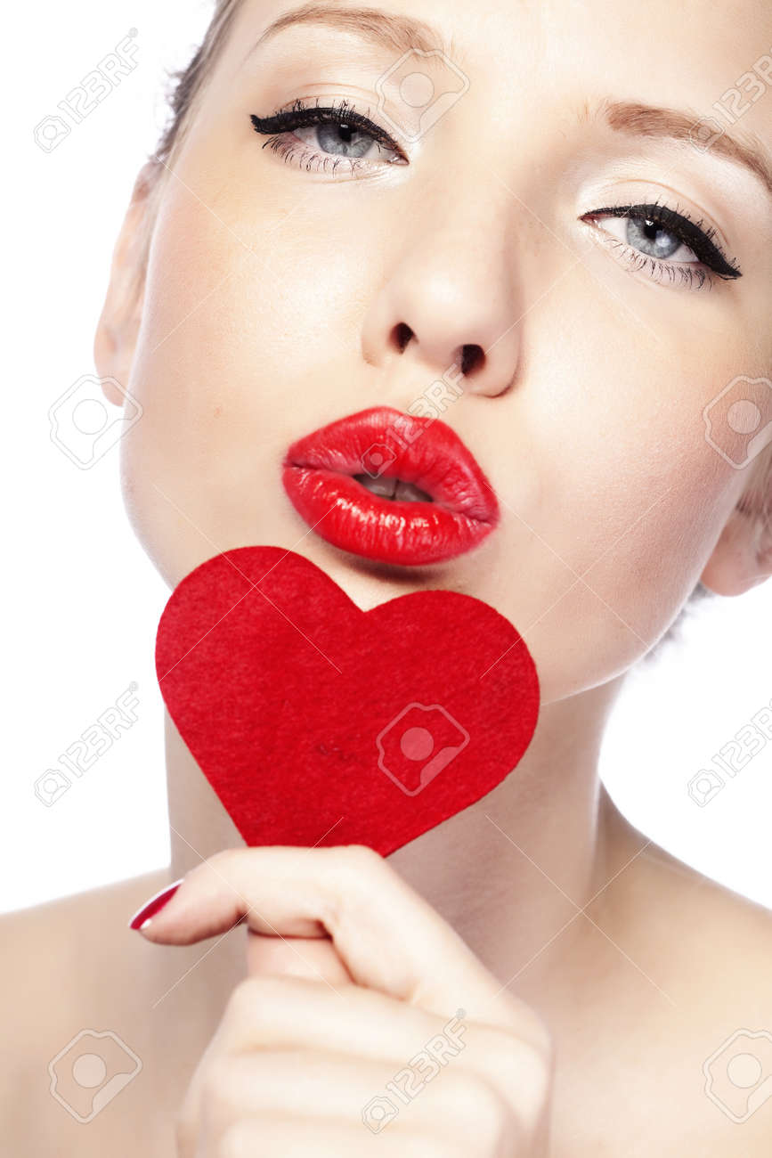 Beautiful gorgeous woman with glamour bright makeup and red heart Stock Photo - 17382154