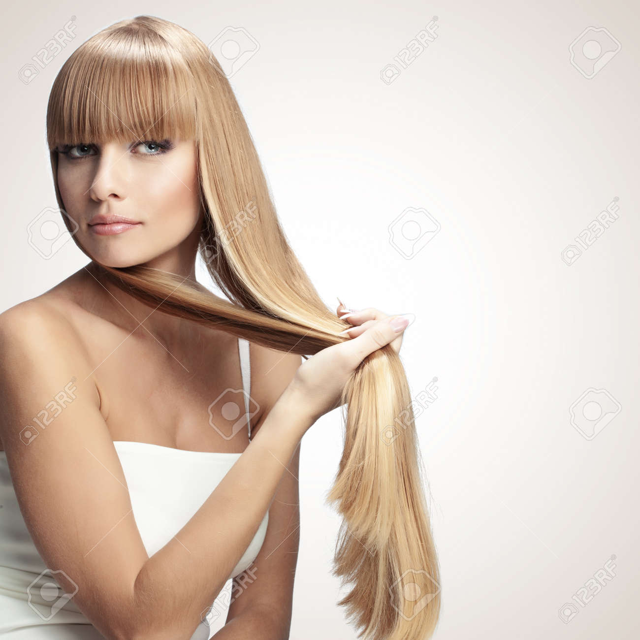 Portrait of beautiful girl with perfect long shiny blond hair studio shot Stock Photo - 18062726