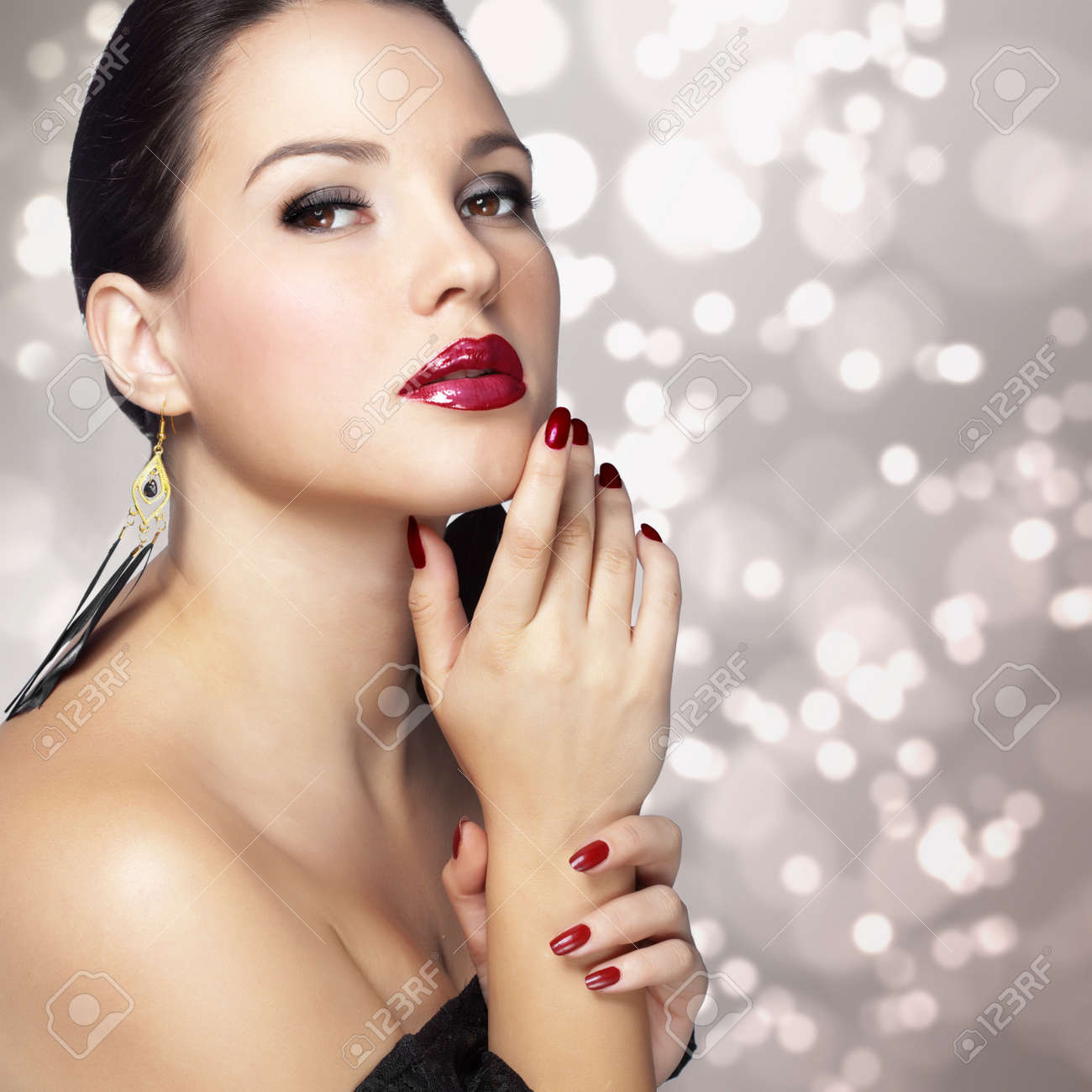 Portrait of beautiful woman with perfect make up over party lights Stock Photo - 18299647