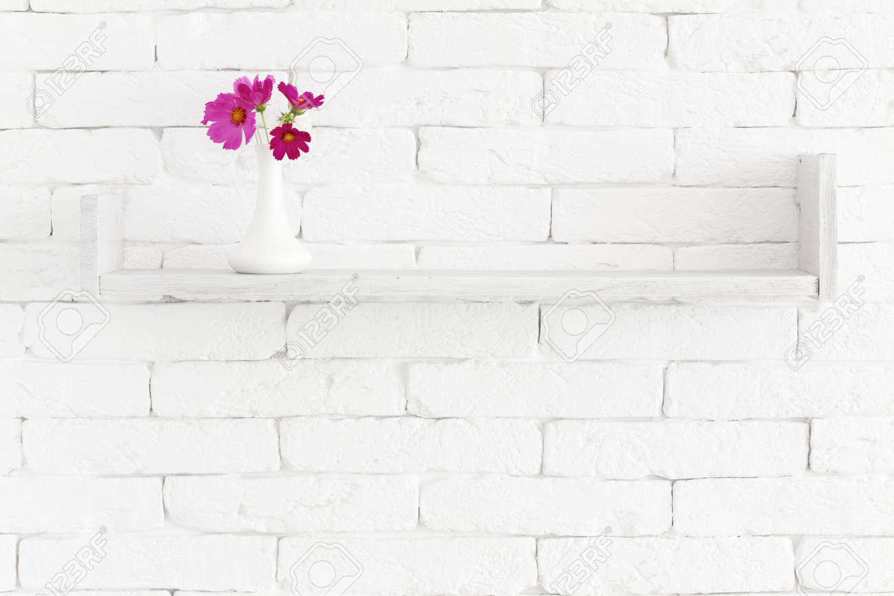 Decorative Shelf On White Brick Wall With Flowers In Vase On Stock Photo Picture And Royalty Free Image Image 21591654