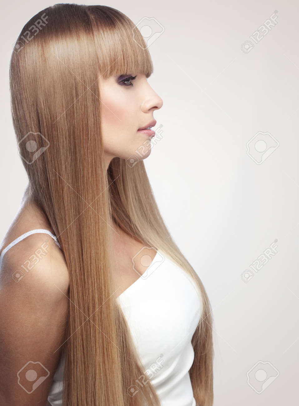 Portrait of beautiful girl with perfect long shiny blond hair studio shot Stock Photo - 21511752
