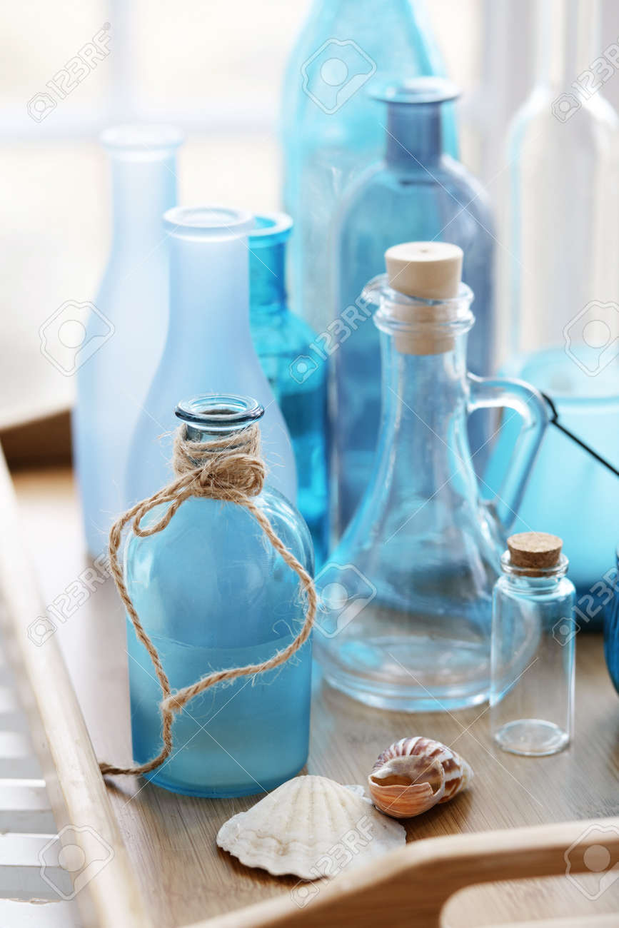 Collection of vintage bottles on a wooden tray Stock Photo - 22486448