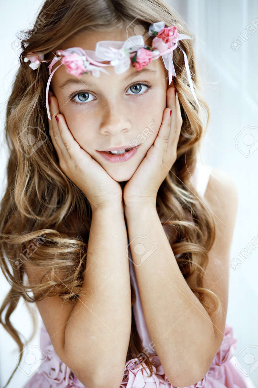 portrait of beautiful little wearing floral wreath stock