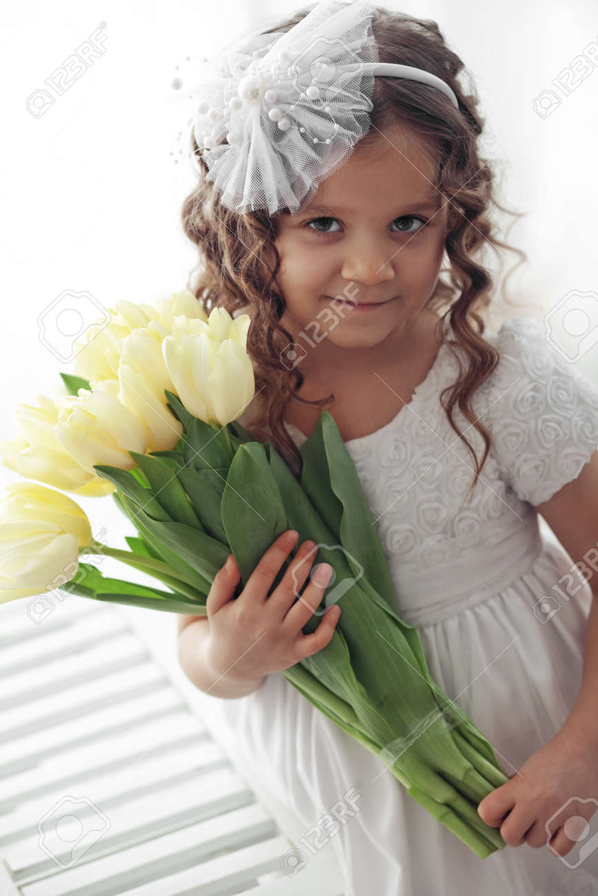 Beautiful Little Princess Wearing Flower Girl Dress Posing With