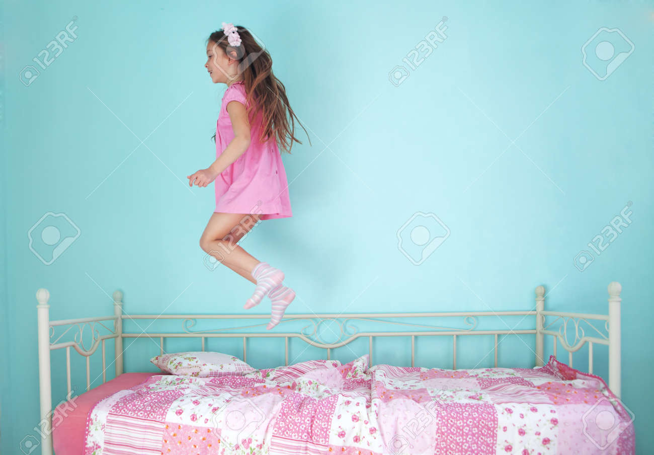 Girl jumping on the bed, sexy black man