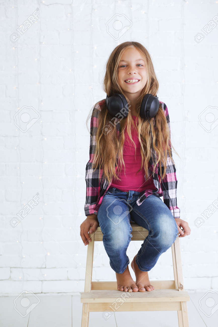 black preteen preteen happy: 8-9 years old stylish teen girl with black headphones posing  on