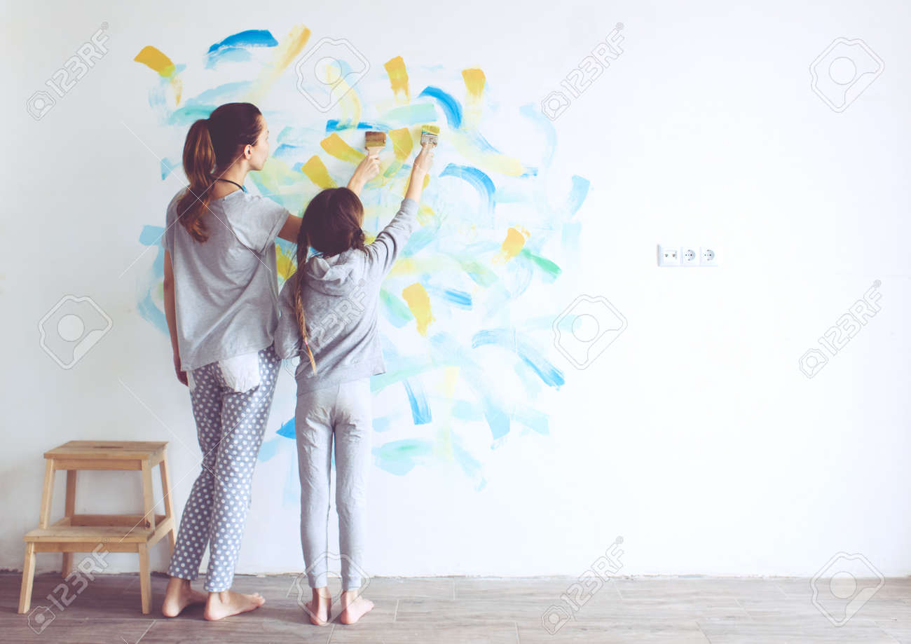 Person painting wall - 8 Years Old Girl Painting The Wall At Home Stock Photo 38198636