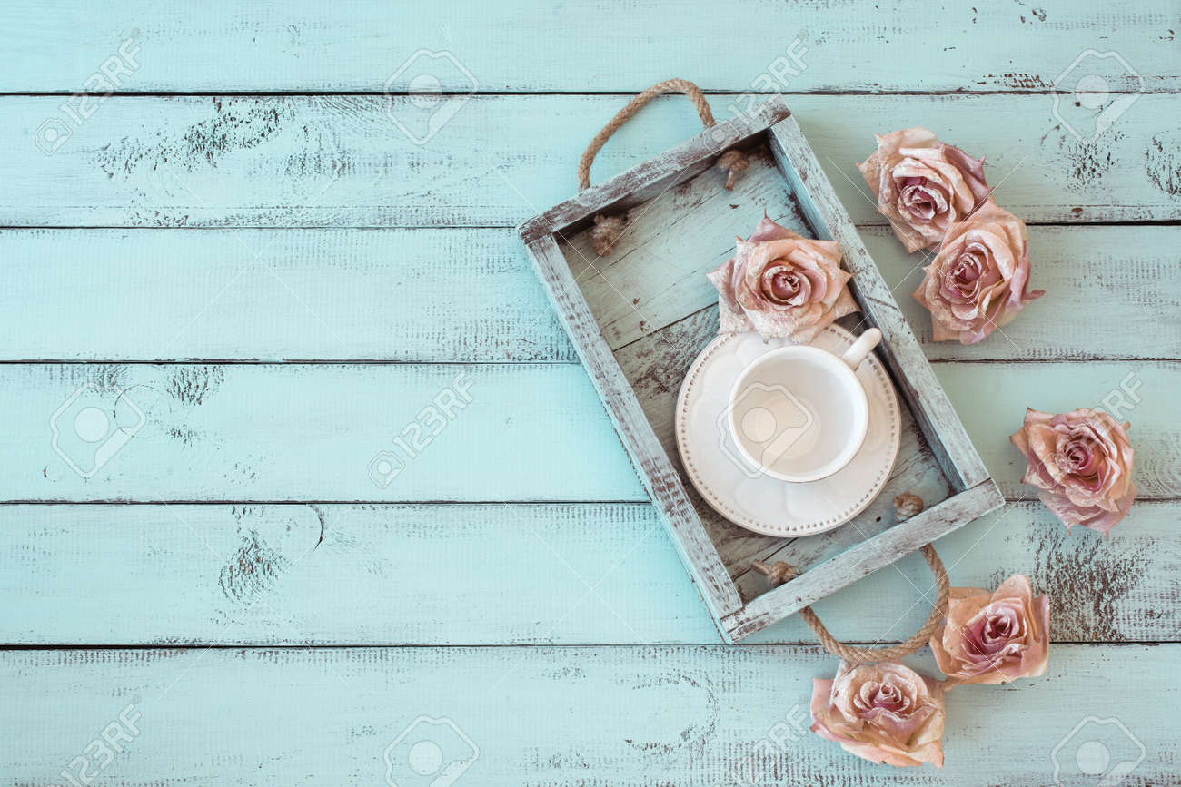 Vintage wooden tray with porcelain teacup and rose buds on shabby chic mint  background  top. Shabby Chic Home Stock Photos  Royalty Free Shabby Chic Home