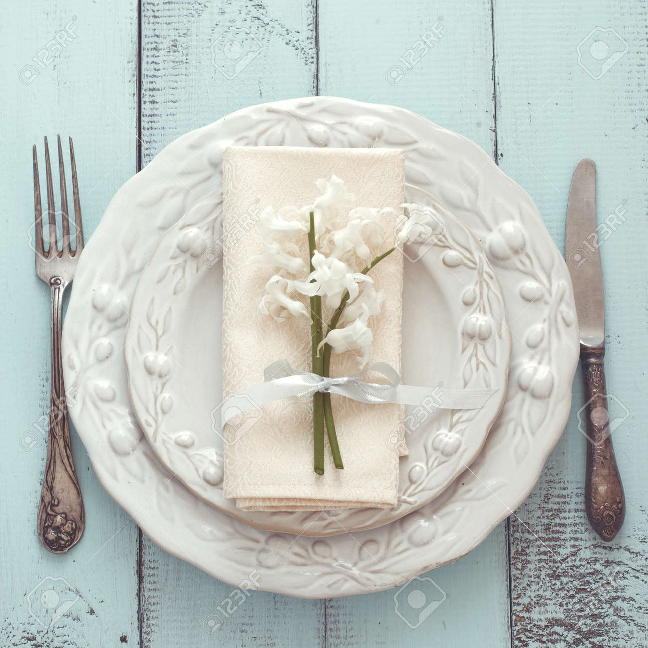 Spring shabby chic table setting on mint wooden background top view point Stock Photo - & Spring Shabby Chic Table Setting On Mint Wooden Background Top ...