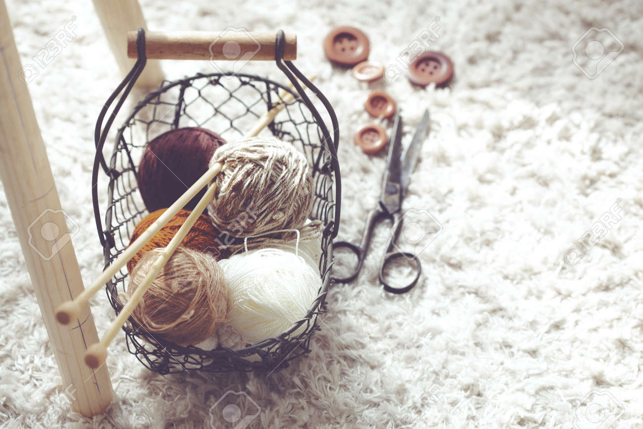 Vintage Knitting Needles, Scissors And Yarn Inside Old Wire Basket ...
