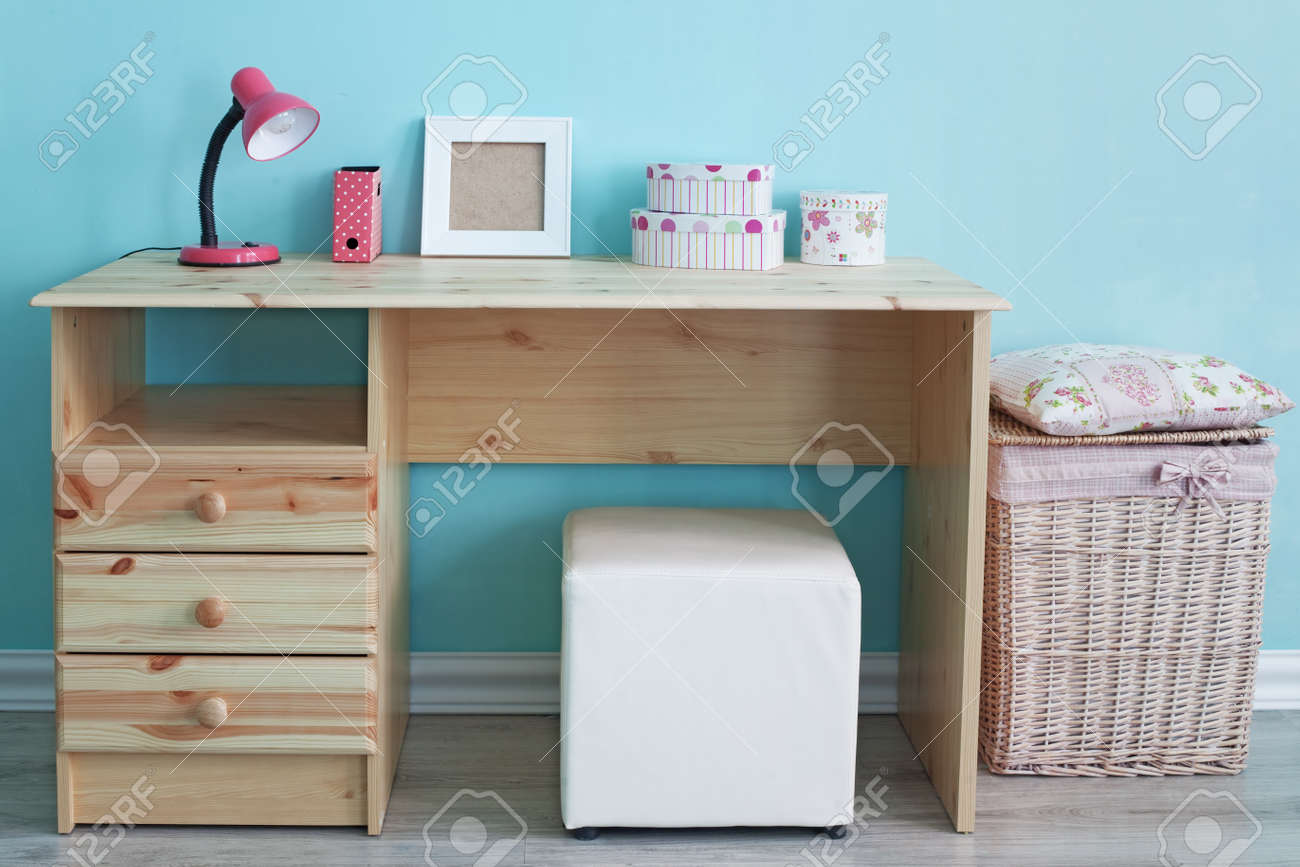 Study Table And Decor For Kid Girl In Bedroom Over Blue Wall Stock