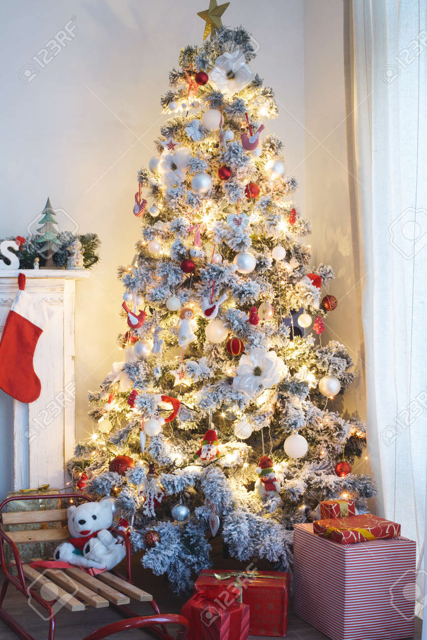 Beautiful Holiday Decorated Room With Christmas Tree With Presents