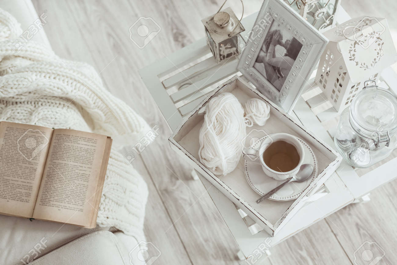 Still life details, cup of tea on retro vintage wooden tray on a coffee  table