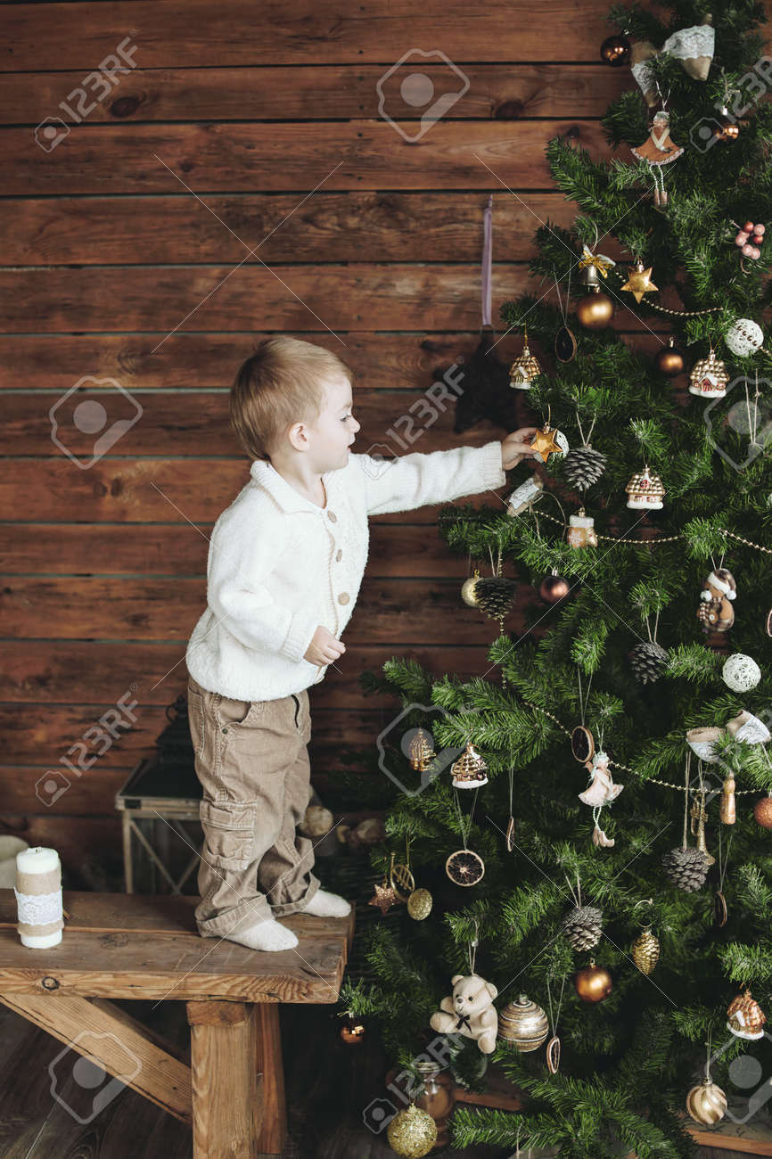 3 Years Old Child Is Decorating Christmas Tree, Farm House Design ...