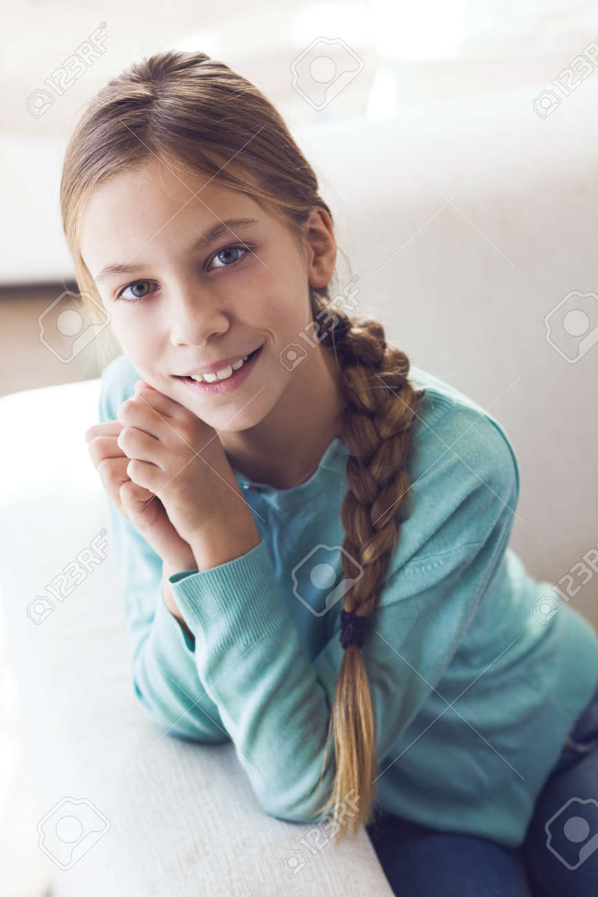 pre-teen nude 9 year old: Home portrait of cute pre teen girl Stock Photo