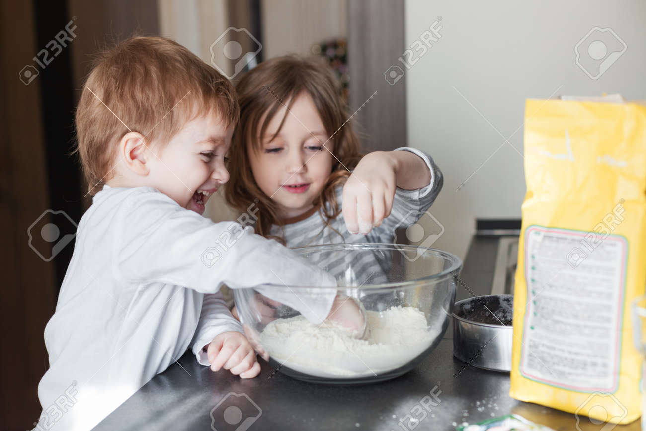 Siblings cooking holiday pie in the kitchen, casual still life photo series - 52019790