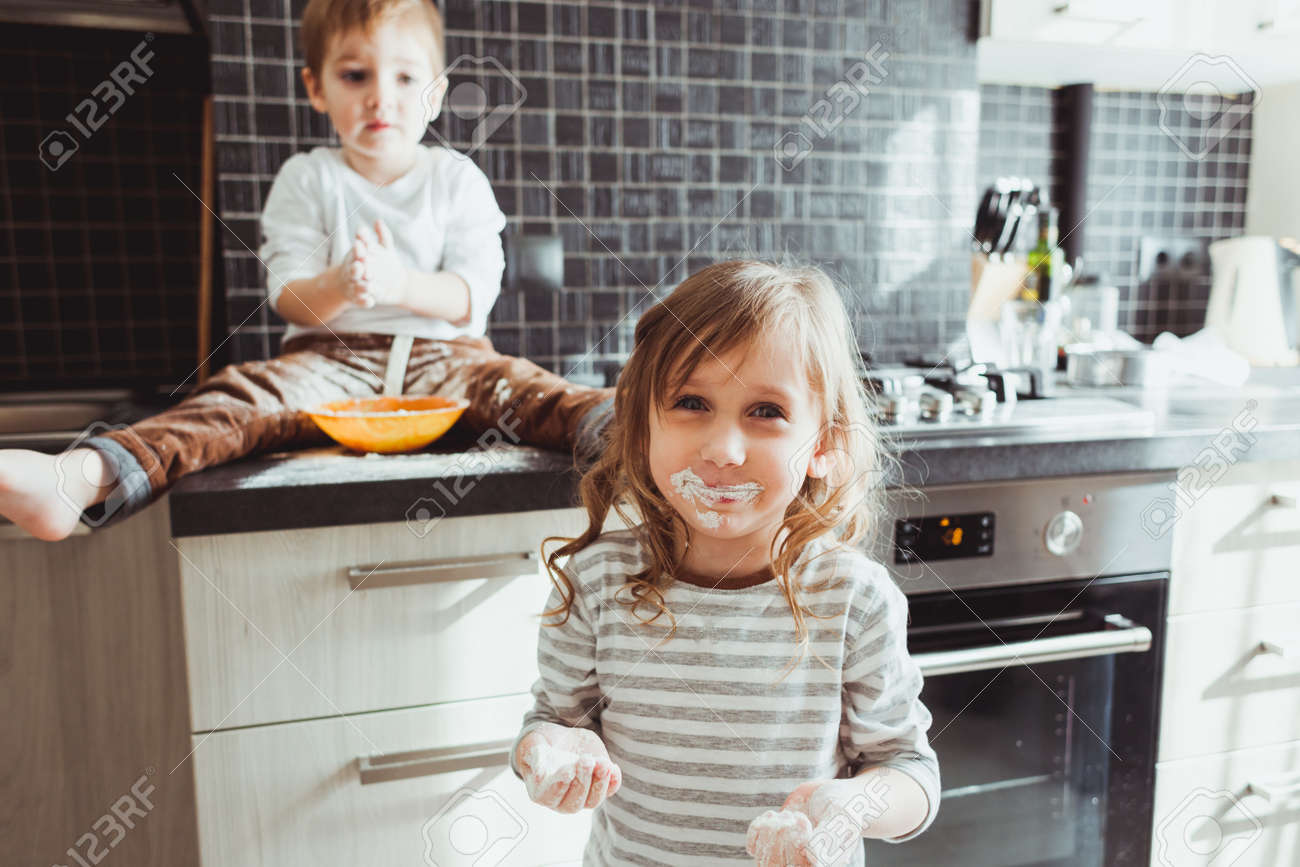 Siblings cooking holiday pie in the kitchen, casual still life photo series - 52019791