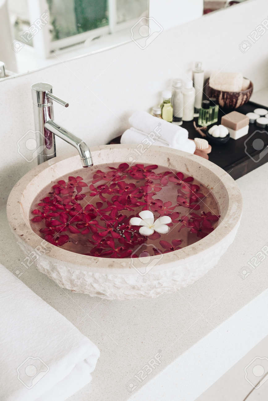 luxury hotel bathroom details sink with flowers spa decoration