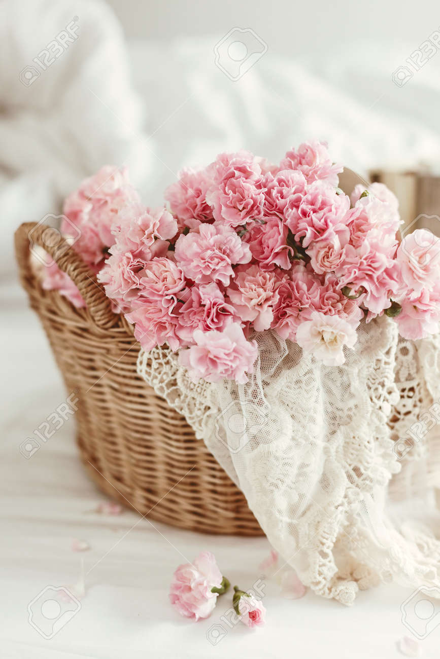 Shabby Chic Style Pink Pastel Flowers In Wicker Basket On The