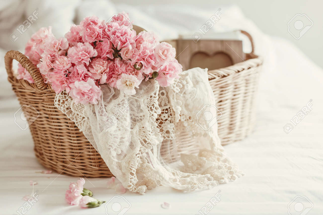 Shabby chic style pink pastel flowers in wicker basket on the pink pastel flowers in wicker basket on the bed stock photo mightylinksfo