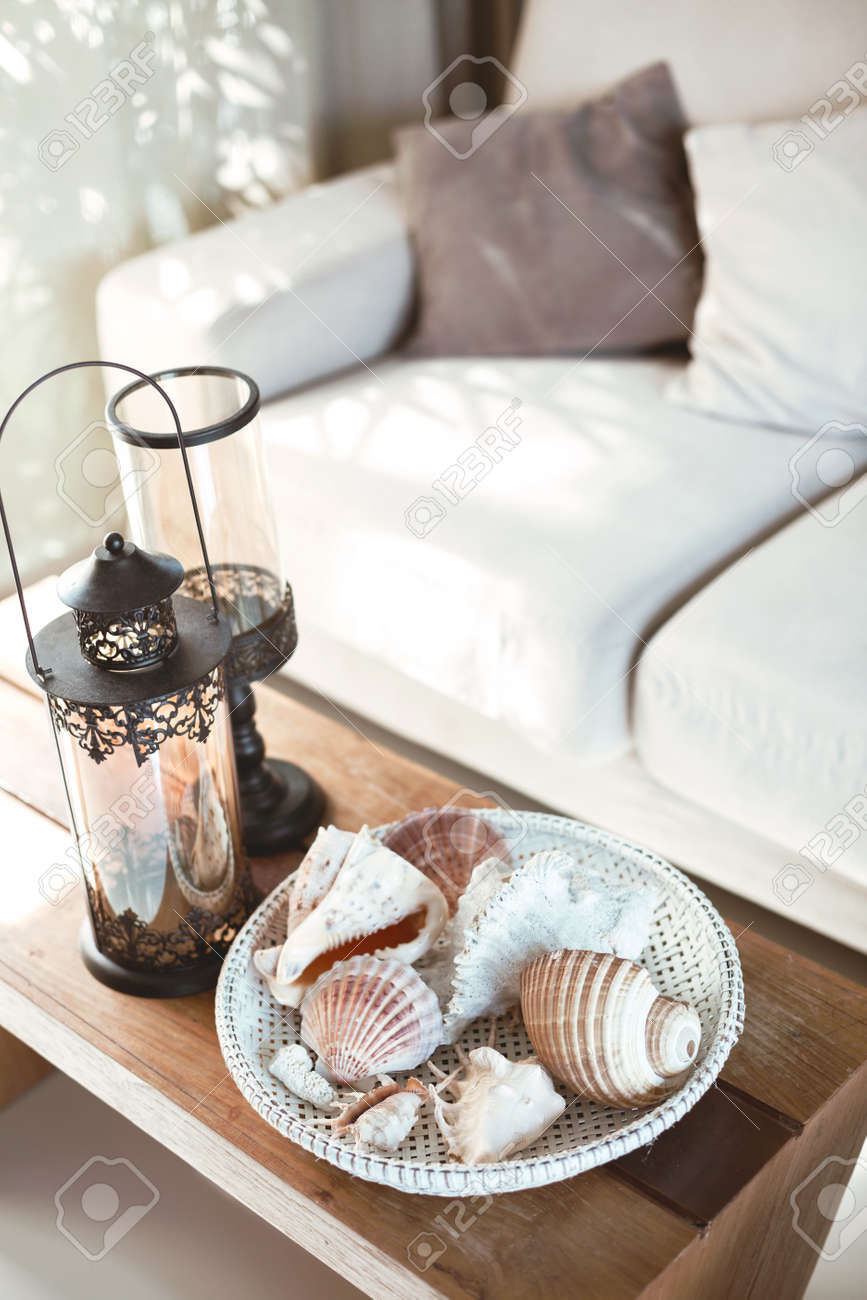 Beach Interior Decor Sea Shells And Lanterns On The Wooden Coffee Stock Photo Picture And Royalty Free Image Image 54741367
