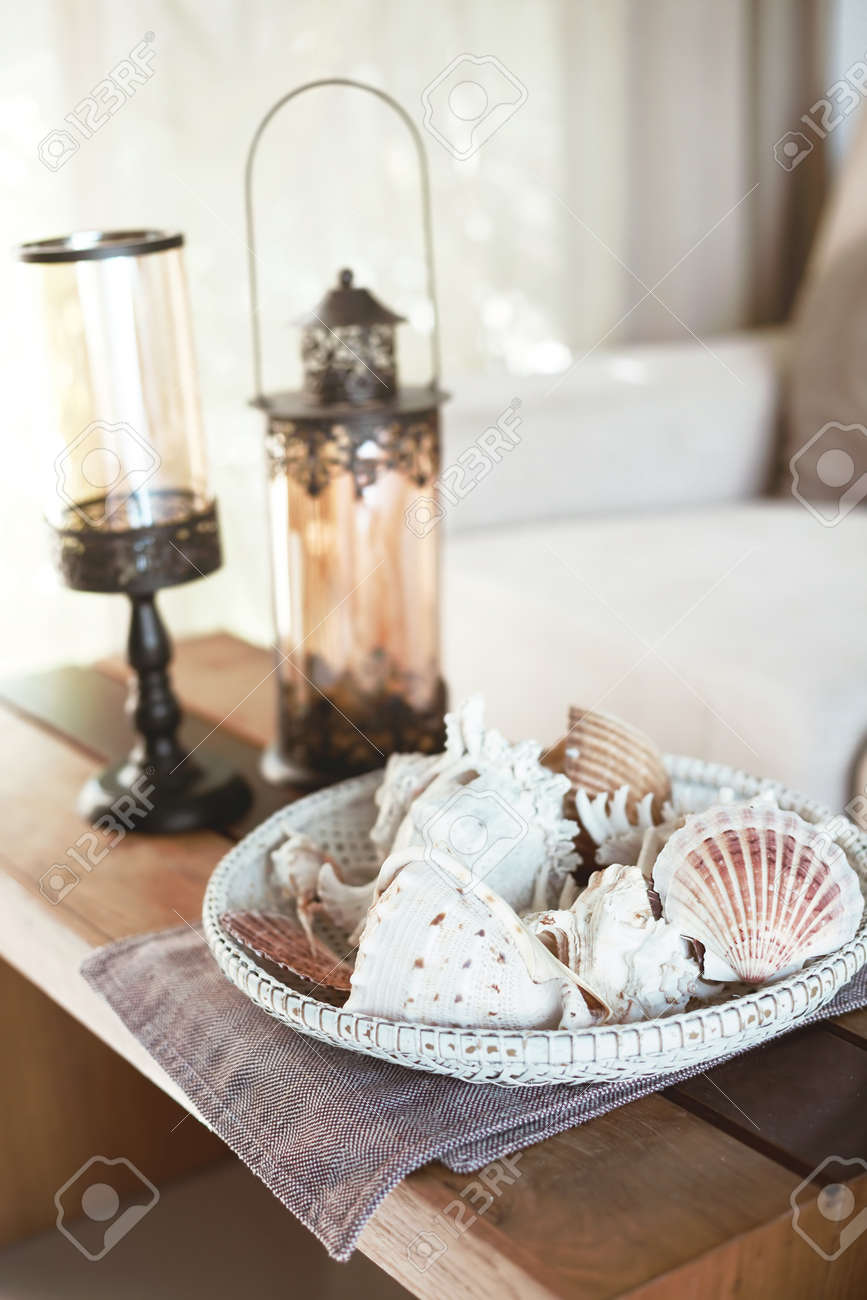 Beach Interior Decor Sea Shells And Lanterns On The Wooden Coffee Stock Photo Picture And Royalty Free Image Image 54741375