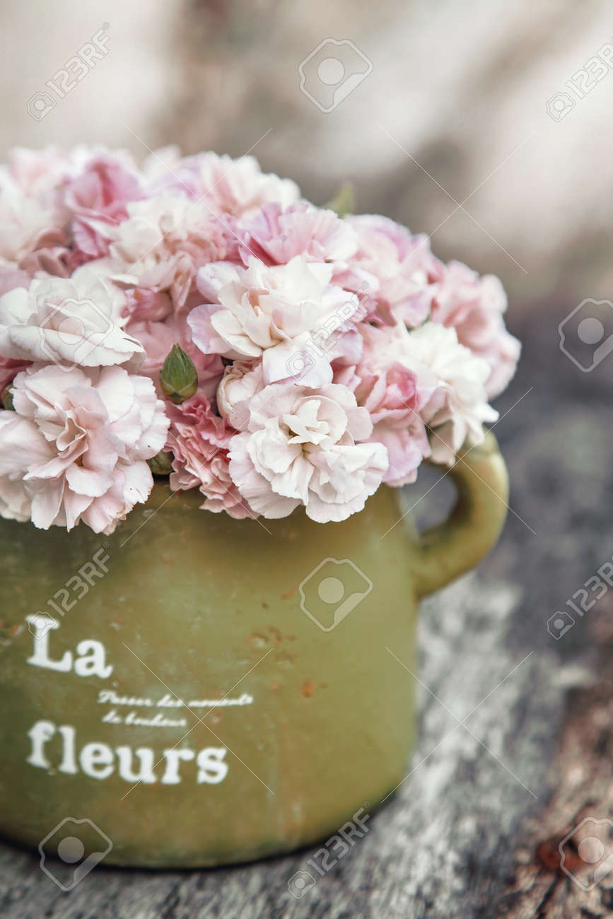 Shabby Chic Flowers In Clay Pot On Rustic Wooden Background Stock ...