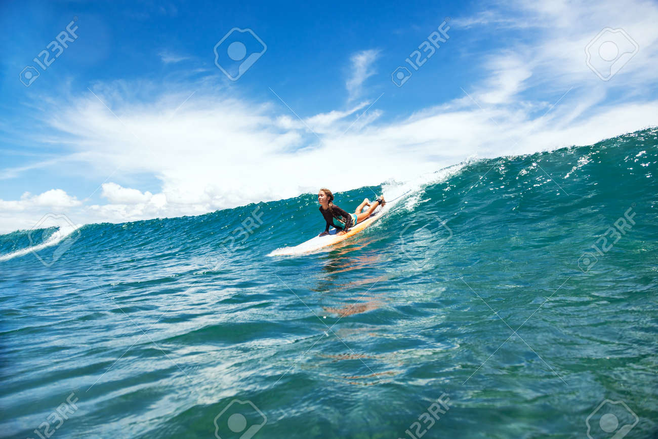 051301c536 Kid Girl Is Learning Surfing, Riding A Wave Stock Photo, Picture And ...