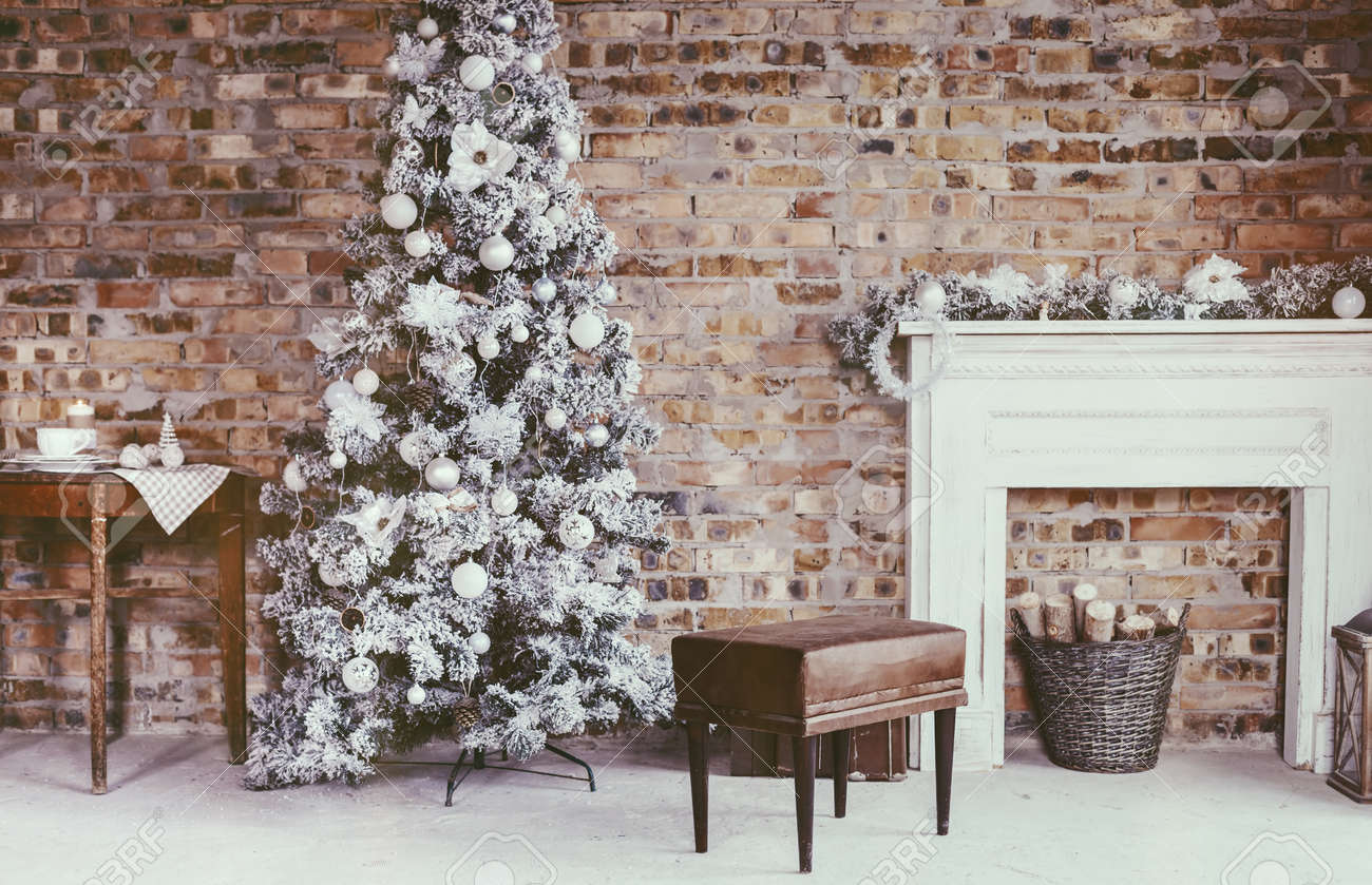 Christmas Tree In Loft Interior Against Brick Wall. Old Vintage Furniture.