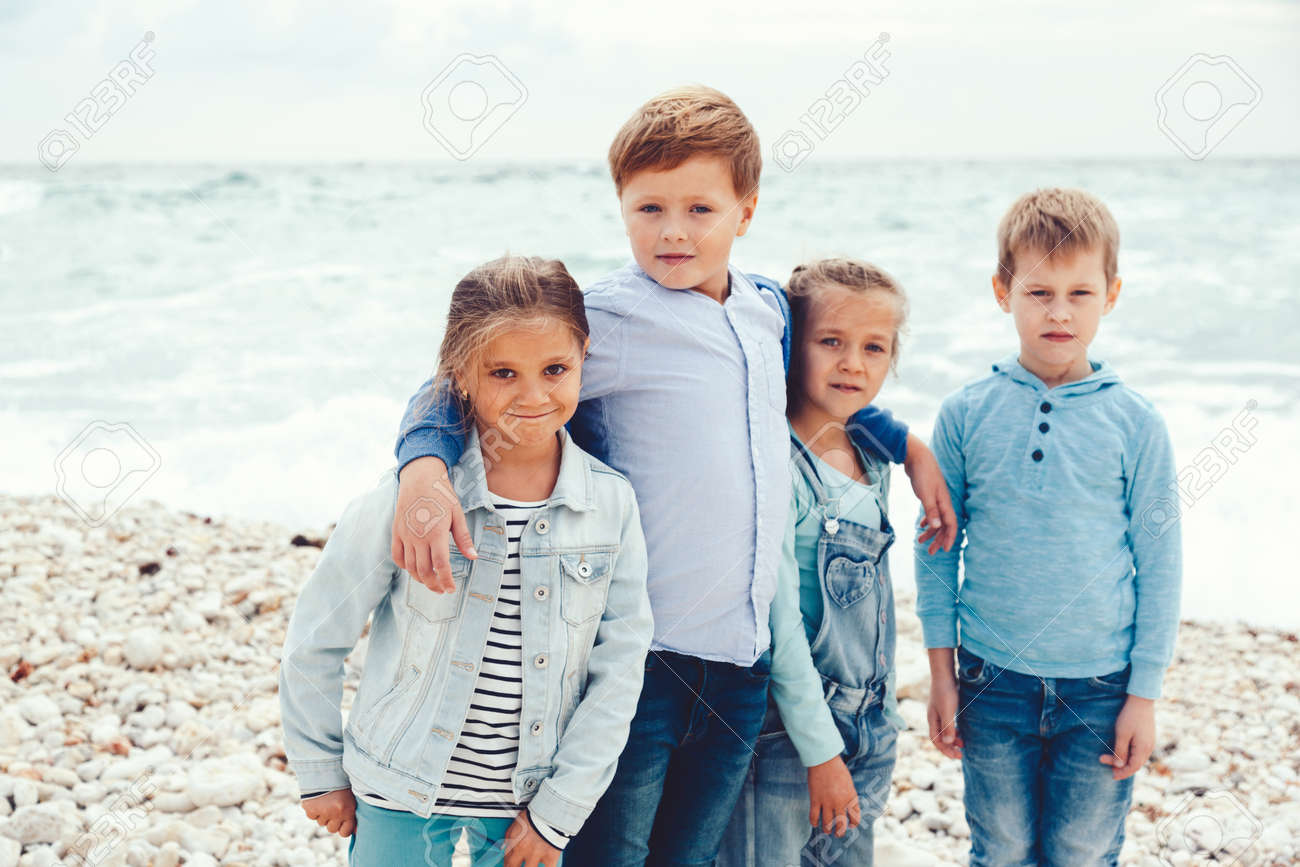 Group Of Fashion Children Wearing Denim Clothing Having Fun On The Sea S Autumn Casual