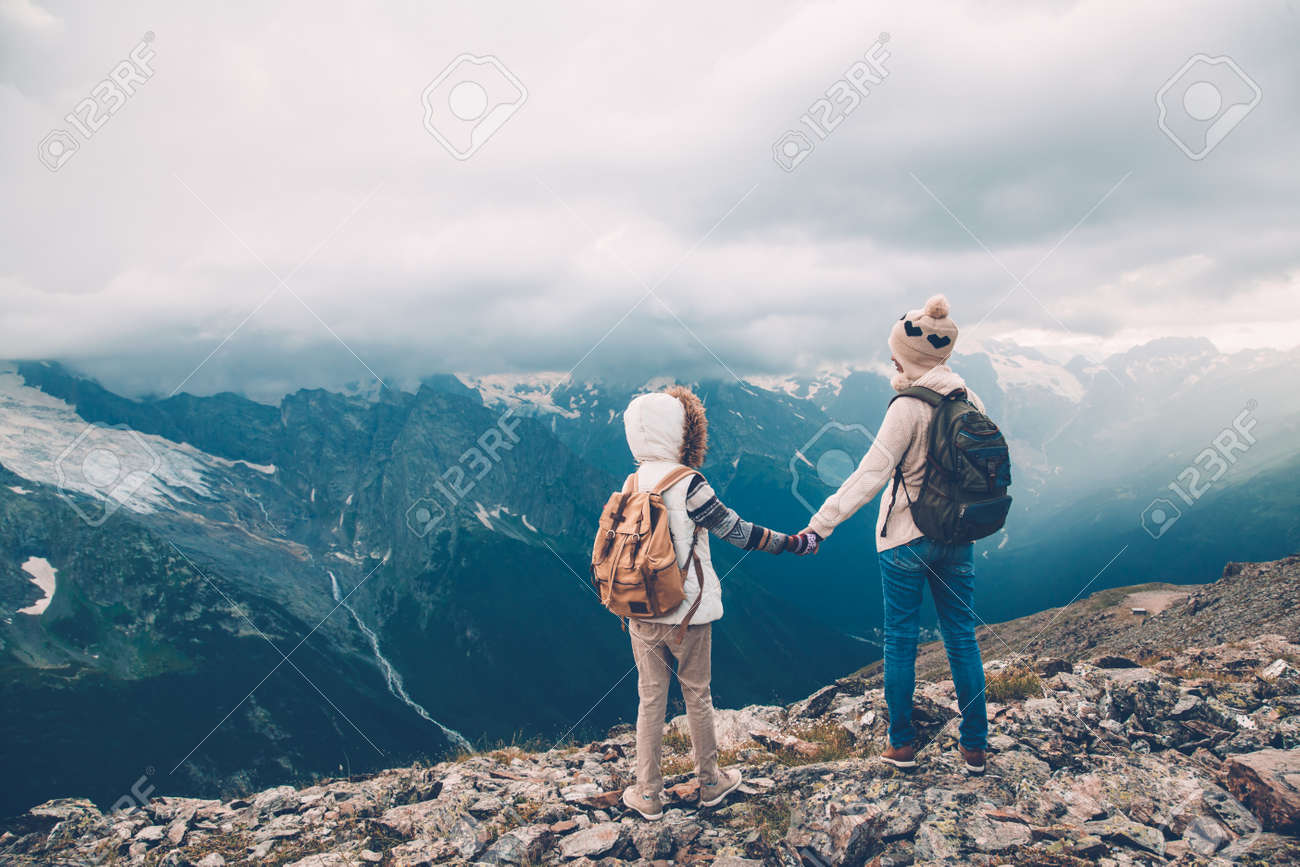 41442ce5de Hikers With Backpack Looking At Mountains