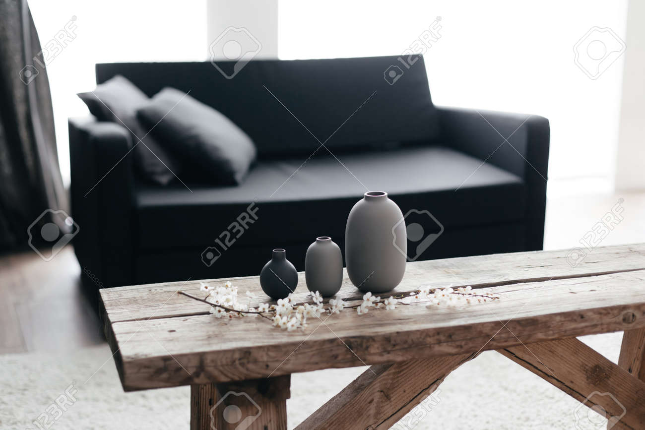 Minimalistic Home Decor On Rustic Coffee Table Over Black Sofa Stock Photo Picture And Royalty Free Image Image 98891955